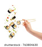 falling pieces of sushi and... | Shutterstock . vector #763804630