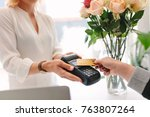 hand of customer making payment ... | Shutterstock . vector #763807264