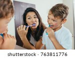 mother and son brushing teeth... | Shutterstock . vector #763811776
