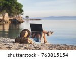 young woman using laptop... | Shutterstock . vector #763815154
