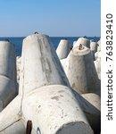 Small photo of Concrete tetrapod on the bank of the Baltic Sea. Baltiysk, Kaliningrad region