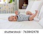 cute little smiling newborn... | Shutterstock . vector #763842478