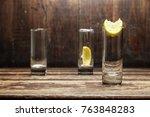 Three Empty Shot Glasses For...