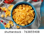 bowl with tasty corn flakes on... | Shutterstock . vector #763855408
