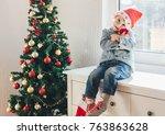 little boy with santa hat... | Shutterstock . vector #763863628