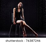 young sexy woman sitting. water