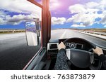 view from cabine of big truck on the mountians road - stock photo