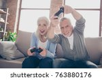 middle aged couple excited... | Shutterstock . vector #763880176