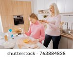 pleasant joyful aged woman... | Shutterstock . vector #763884838