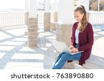 young girl working on laptop... | Shutterstock . vector #763890880