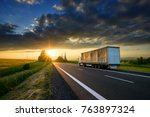 truck driving on the asphalt... | Shutterstock . vector #763897324