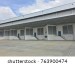 Small photo of A loading dock or loading bay is an area of a building where goods vehicles are loaded and unloaded. They are commonly found on commercial and industrial buildings, and warehouses in particular.