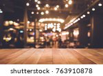 wood table top  bar  with blur... | Shutterstock . vector #763910878