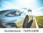 car in nature on an asphalt... | Shutterstock . vector #763911898