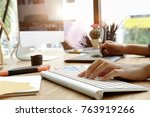 young graphic designer using... | Shutterstock . vector #763919266