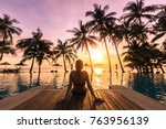 woman relaxing by the pool in a ... | Shutterstock . vector #763956139
