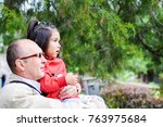 grandfather with little... | Shutterstock . vector #763975684