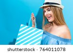 young woman holding a shopping... | Shutterstock . vector #764011078