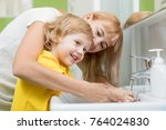 mother and child son washing... | Shutterstock . vector #764024830