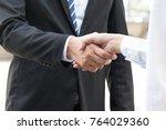 businessman is shaking hand... | Shutterstock . vector #764029360