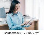 asian businesswoman use tablet... | Shutterstock . vector #764039794