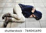 guy in a hoodie fetal position... | Shutterstock . vector #764041690