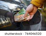 man hand put money to opening... | Shutterstock . vector #764046520