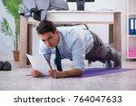 businessman doing sports in... | Shutterstock . vector #764047633