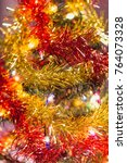 red and gold tinsel and small... | Shutterstock . vector #764073328