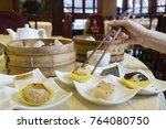enjoying yumcha at a... | Shutterstock . vector #764080750