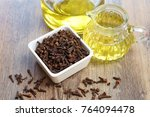 clove essential oil with clove | Shutterstock . vector #764094478