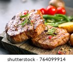 Grilled Beef Steaks On Wooden...