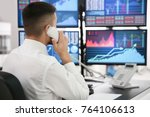 male stock trader working in... | Shutterstock . vector #764106613