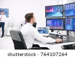 male stock trader working in... | Shutterstock . vector #764107264