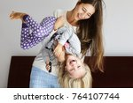 beautiful mother and daughter... | Shutterstock . vector #764107744