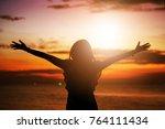 human hands open palm up... | Shutterstock . vector #764111434