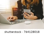 close up of hand using tablet ... | Shutterstock . vector #764128018