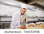 the confectioner is preparing a ... | Shutterstock . vector #764152948