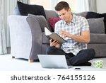 male freelance worker using...   Shutterstock . vector #764155126