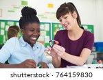 female pupil and teacher using...   Shutterstock . vector #764159830