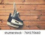 ice hockey skates hanging on... | Shutterstock . vector #764170660