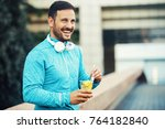 young athlete man eating fruit...   Shutterstock . vector #764182840