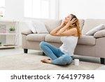 smiling redhead girl listening... | Shutterstock . vector #764197984