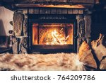 warm cozy fireplace with real... | Shutterstock . vector #764209786