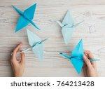 blue origami crane birds. top... | Shutterstock . vector #764213428