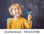 three year old boy shows...   Shutterstock . vector #764213788