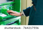 image of woman in coat at green ... | Shutterstock . vector #764217556