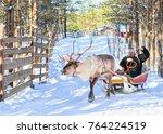 man riding reindeer sled in... | Shutterstock . vector #764224519