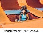 young woman sportsman jumping...   Shutterstock . vector #764226568