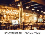 table in blur pub or bar and... | Shutterstock . vector #764227429